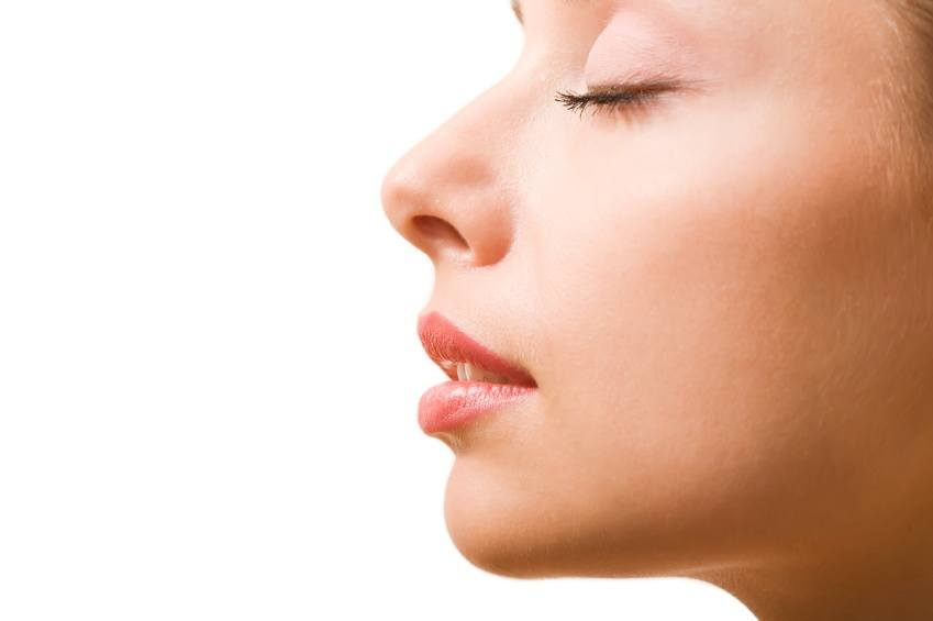 How is rhinoplasty performed?